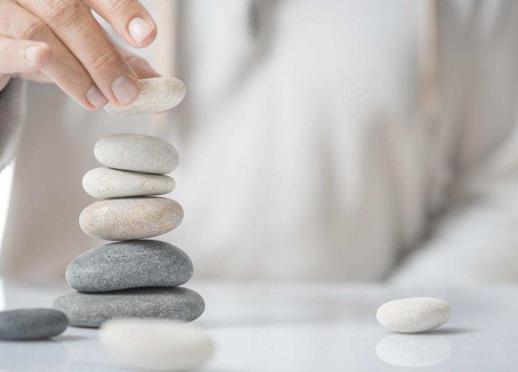 personal meditating stacking rocks