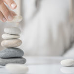 personal meditating stacking rocks