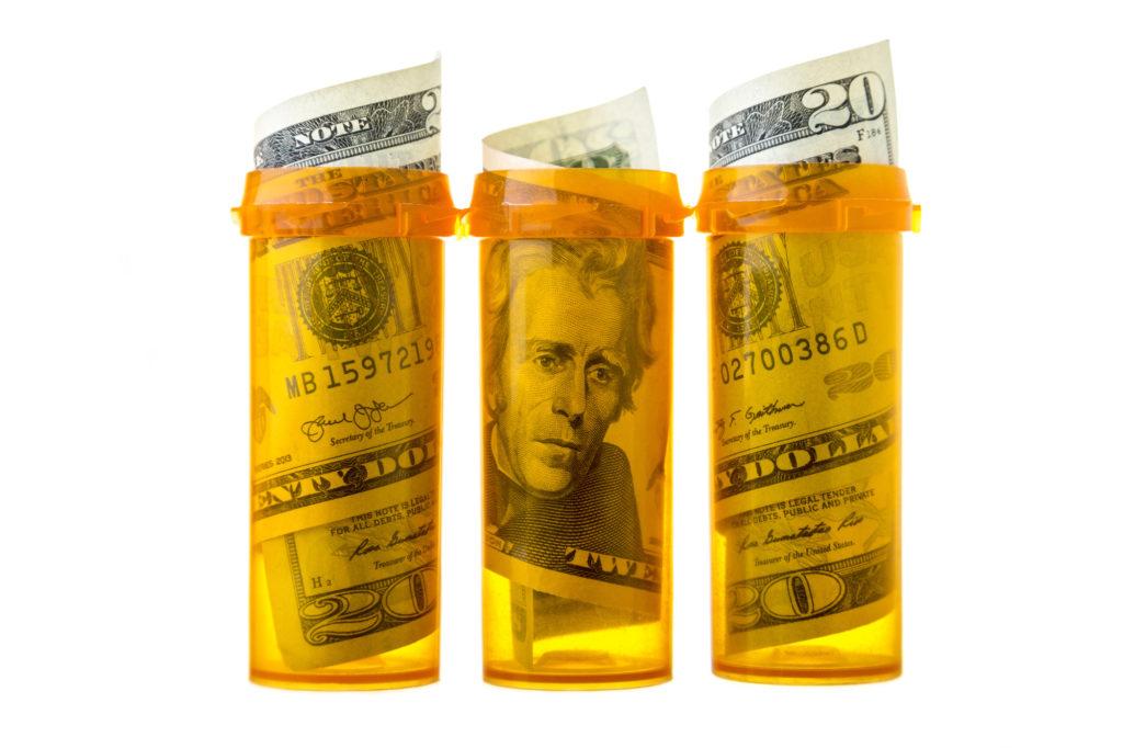pills bottles and money