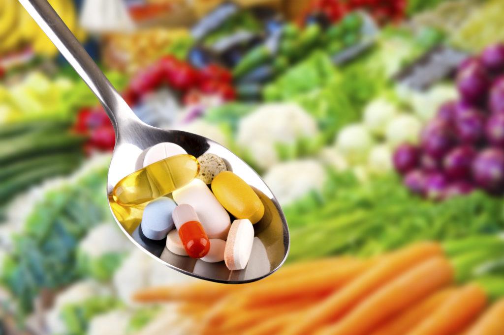 healthy vitamins on a spoon