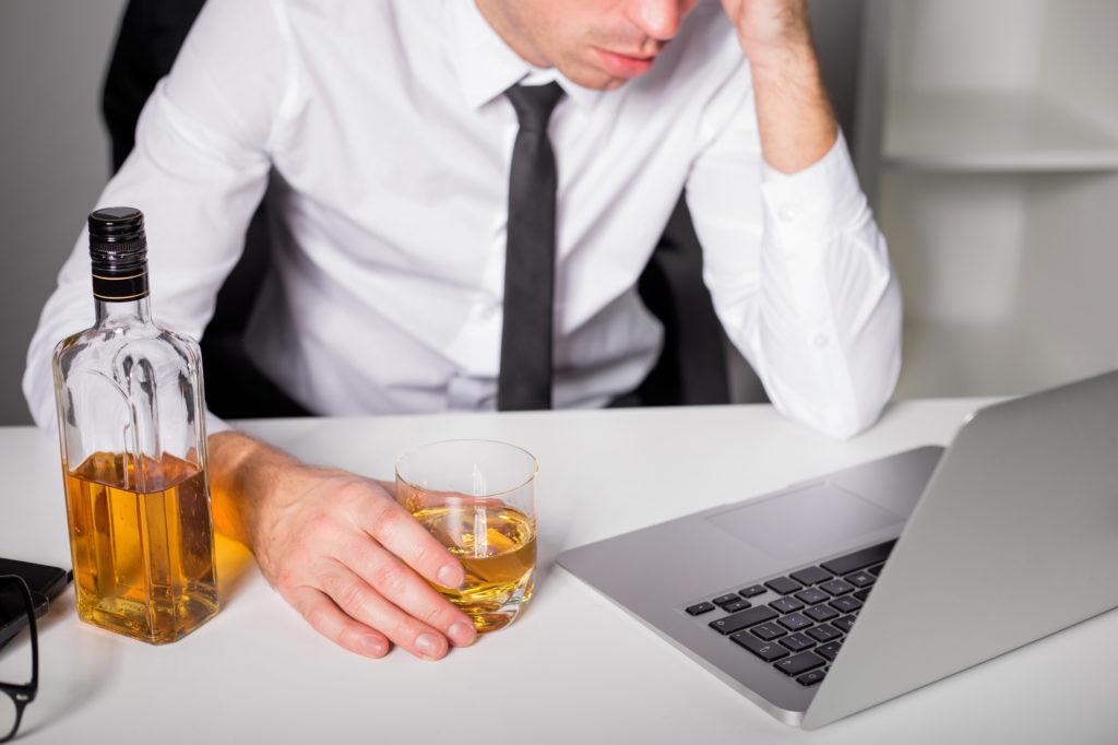 man having a drink