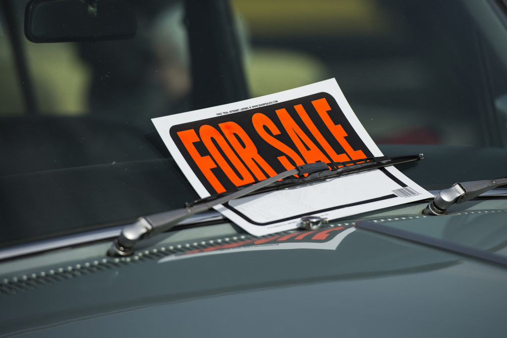 car with a for sale sign on it