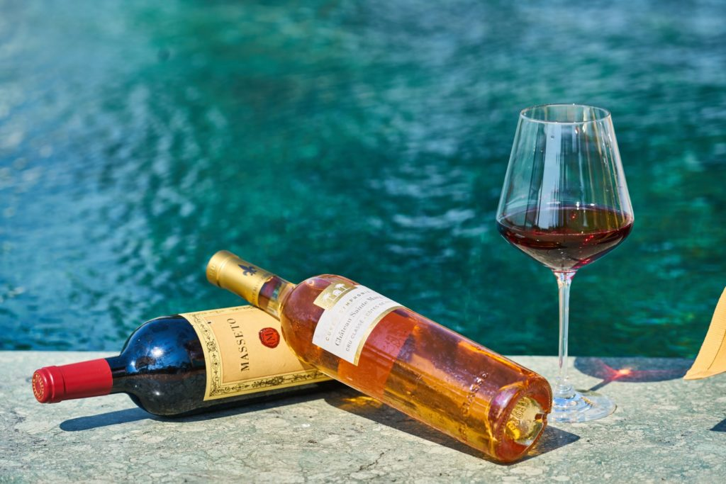 wine bottle by the pool